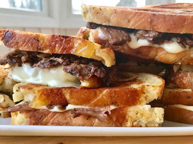 Pot Roast Sandwiches -- Tender beef roast made in the crock pot and piled onto sandwiches with goozy cheese and grilled to sandwich perfection! | thatwhichnourishes.com