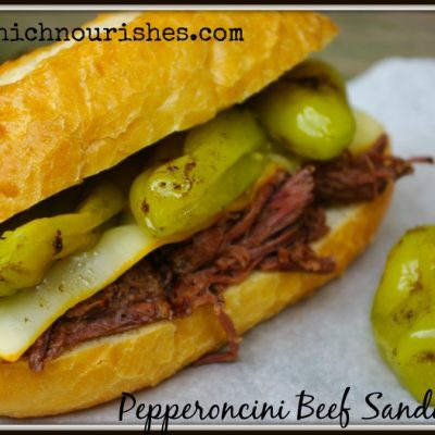 Pepperoncini Beef Sandwiches -- Flavor-packed sandwiches with beef that falls apart flavored with tangy pepperoncini peppers and smothered with cheese. | thatwhichnourishes.com