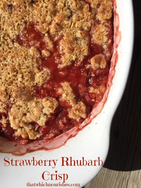 Strawberry Rhubarb Crisp -- Strawberries and rhubarb get married and make a delicious combination of sweet and tart under a crispy blanket of buttery oats and brown sugar. | thatwhichnourishes.com
