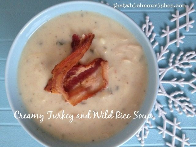 Creamy Turkey and Wild Rice Soup -- the perfect way to use up leftover turkey or a rotisserie chicken. A thick, creamy, flavorful soup garnished with bacon | thatwhichnourishes.com