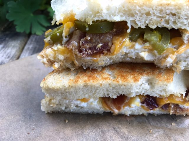 Bacon Jalapeno Popper Sandwiches -- Bacon, ranch flavors, cream cheese, Cheddar cheese, and jalapeños are grilled and gooey inside a warm, crispy, buttery sandwich. | thatwhichnourishes.com