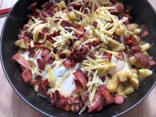 Breakfast Skillet -- Your favorite elements of breakfast (bacon, potatoes and eggs) made in one skillet and covered in cheese. Does it get any better? | thatwhichnourishes.com