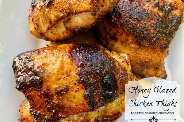 Honey Glazed Chicken Thighs -- Flavored with spices and broiled in under 30 minutes, these inexpensive chicken thighs are caramelized with a honey glaze for a simple and delicious meal! | thatwhichnourishes.com