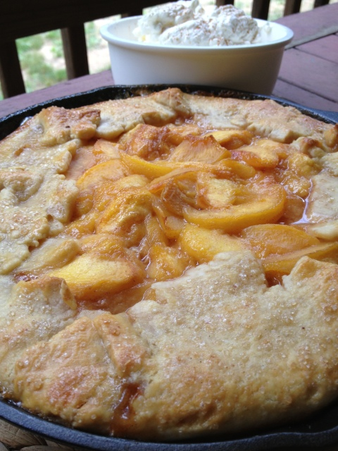 Rustic Peach Pie -- It has all the soft, peachy deliciousness you crave in a rustic, almond crust in a cast iron skillet which just adds charm to the drool-worthiness. | thatwhichnourishes.com