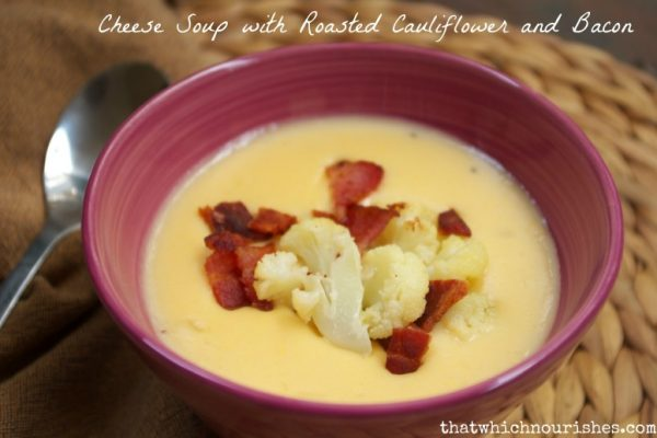 Cheese Soup with Roasted Cauliflower and Bacon -- Smooth, creamy and savory, this cheese soup is made unique by adding roasted cauliflower with a secret ingredient and garnished with bacon. | thatwhichnourishes.com