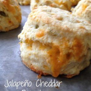 Jalapeño Cheddar Biscuits -- Fluffy, buttery, cheesy bites of yum with goozey cheese and a kick of spice with bits of jalapeños. Spicy, buttery, perfectly fluffy biscuits. | thatwhichnourishes.com