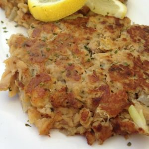 Salmon Patties -- Canned salmon transforms into a crispy, flavorful patty of yum with just a little help from this great recipe. An easy way to sneak salmon into your family's meals in a way they will love. | thatwhichnourishes.com