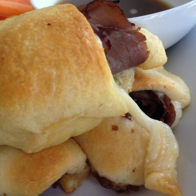 French Dip Crescents with easy Au Jus -- Easy, peasy and they taste like gooey deliciousness that can be made in no time. Deli roast beef, crescent rolls, and cheese make an impressive lunch if you need to impress, but also a quick, weeknight dinner. | thatwhichnourishes.com