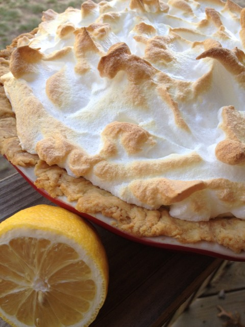 Classic Lemon Meringue Pie -- The perfect slice of lemon pie. Bright, lemony custard baked under a fluffy meringue sure to knock socks off. | thatwhichnourishes.com