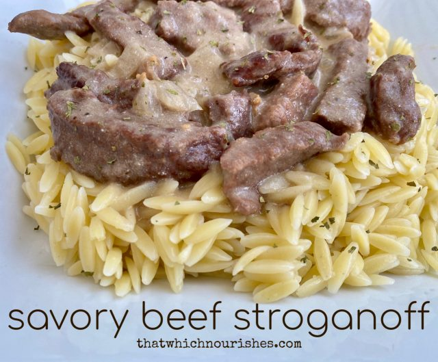 Savory Beef Stroganoff -- Tender strips of beef swimming in a rich and savory gravy and served over a bed of buttery noodles or polenta, this classic dish is simple, nourishing, and the essence of comfort food. | thatwhichnourishes.com