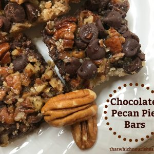 Chocolate Pecan Pie Bars -- Gooey pecan pie filling with the added benefit of rich chocolate. Just like chocolate pecan pie but happier as it's easier to serve! | thatwhichnourishes.com