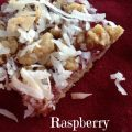 Raspberry Coconut Bars -- A shortbread-like crust containing oats and toasted coconut is blanketed with raspberries and more coconut to make a bar of yum that is unique and fruity. | thatwhichnourishes.com