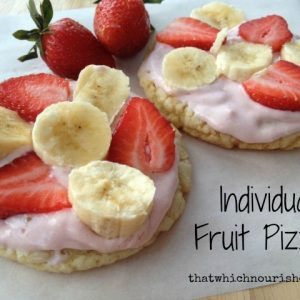 Individual Fruit Pizzas -- These little beauties take traditional fruit pizzas up a notch making them extra delicious with a marshmallow topping and fully customizable. | thatwhichnourishes.com