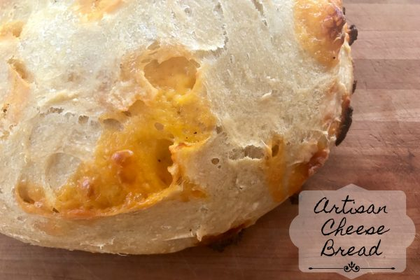 Artisan Cheese Bread -- Crispy on the outside, soft on the inside, this recipe makes two loaves of Artisan Cheese Bread that may be the easiest most amazing bread you've ever had. No kneading needed! | thatwhichnourishes.com