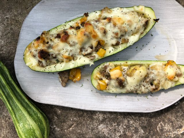 Cheesy Sausage Zucchini Boats -- The easy way to turn summer bounty into savory, flavor-rich food that everyone will love. | thatwhichnourishes.com