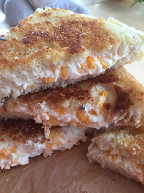 THE Grilled Cheese -- You'll just never eat one this good, I pretty much promise. Loaded with fresh garlic and a cheesy filling that's just too good to be true. | thatwhichnourishes.com