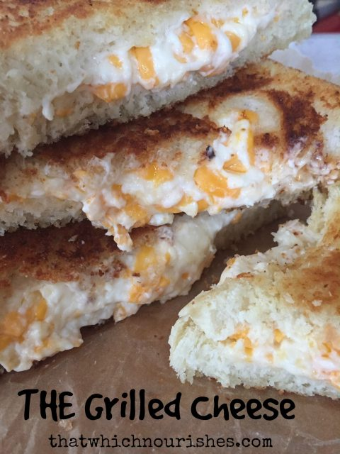 THE Grilled Cheese -- You'll just never eat one this good, I pretty much promise. Loaded with fresh garlic and a cheesy filling that's just too good to be true, I guarantee true love at first bite. | thatwhichnourishes.com