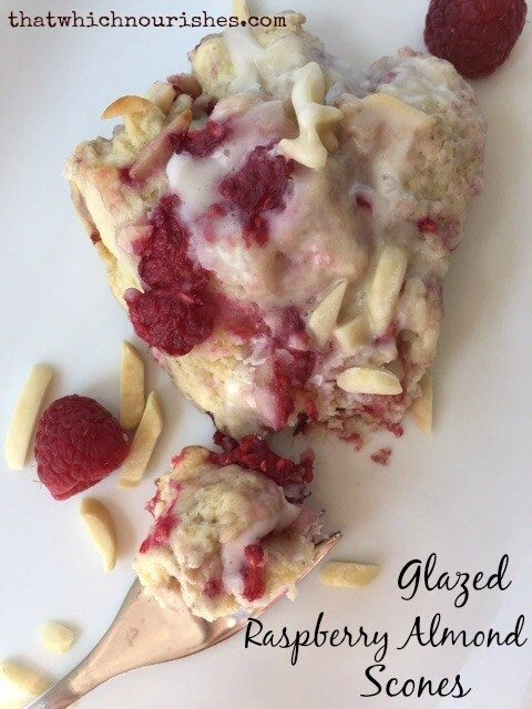 Glazed Raspberry Almond Scones -- soft, moist, buttery scones studded with fresh raspberries and blanketed in a sugary glaze | thatwhichnourishes.com