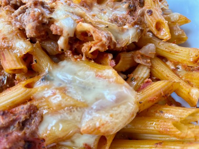 Ultimate Cheesy Pasta Bake -- Meat and pasta meet prepared red sauce, mozzarella, and seasonings and with a quick mix and bake you have gooey, cheesy yum.   thatwhichnourishes.com