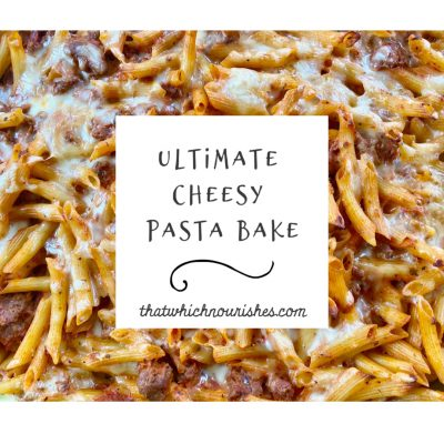 Ultimate Cheesy Pasta Bake -- Meat and pasta meet prepared red sauce, mozzarella, and seasonings and with a quick mix and bake you have gooey, cheesy yum. | thatwhichnourishes.com