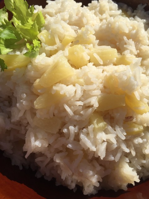 Pineapple Coconut Rice -- Creamy, coconut-y rice with hints of sweetness from pineapple. This easy rice makes a perfect and unique side dish ideal with chicken, fish, or pork. | thatwhichnourishes.com