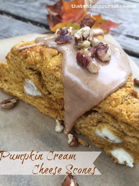 Pumpkin Cream Cheese Scones -- Pumpkin Cream Cheese Scones with maple cinnamon glaze take pumpkin scones to a whole new level with creamy cheese and a gooey glaze made with maple syrup.   thatwhichnourishes.com