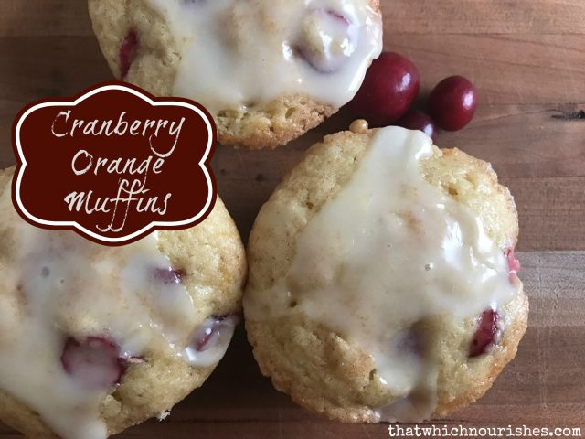 Glazed Cranberry Orange muffins -- A sweet, fluffy, orange-y muffin with little bursts of tart cranberry, covered with a tangy sweet orange glaze. | thatwhichnourishes.com
