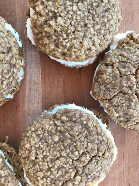 Oatmeal Cream Pies -- Pillowy soft buttery frosting is sandwiched between two soft oatmeal cookies spiced to perfection.   thatwhichnourishes.com