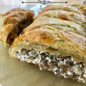 Cheesy Sausage Breakfast Braid -- Creamy cheese and savory sausage meet inside a flaky, buttery pastry to make a simple, yet spectacular breakfast or brunch showstopper. | thatwhichnourishes.com