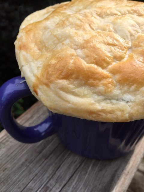 Cheesy Chicken Pot Pie -- Tender chunks of turkey or chicken and the veggies of your choice basking in a cheesy, rich and savory sauce, topped with buttery puff pastry and baked to pot pie perfection in less than an hour! | thatwhichnourishes.com