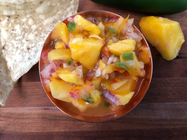Must-Have Mango Salsa -- A delightful blend of sweet and a bit spicy (totally adjustable to taste) and comes together in minutes. Great on fish or chicken or as a snack! | thatwhichnourishes.com