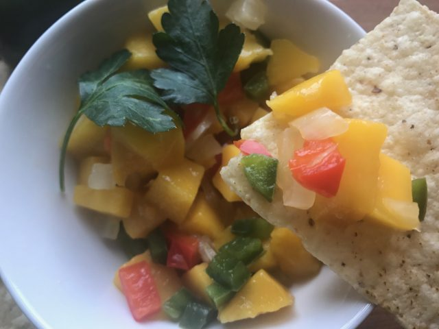 Must-Have Mango Salsa -- A delightful blend of sweet and a bit spicy (totally adjustable to taste) and comes together in minutes. Great on fish or chicken or as a snack!   thatwhichnourishes.com