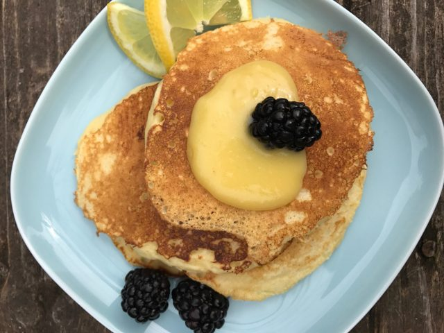 Lemon Ricotta Pancakes are melt-in-your-mouth tender pancakes that are almost crepe-like with a hint of lemon. This is how to put a delightful spin on breakfast or brunch. | thatwhichnourishes.com