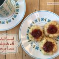 Coconut Thumbprint Cookies with Cherry or Lemon -- Buttery shortbread cookies are covered in coconut and filled with tart jam or homemade lemon curd for a rich cookie in a beautiful little bundle of yum.   thatwhichnourishes.com