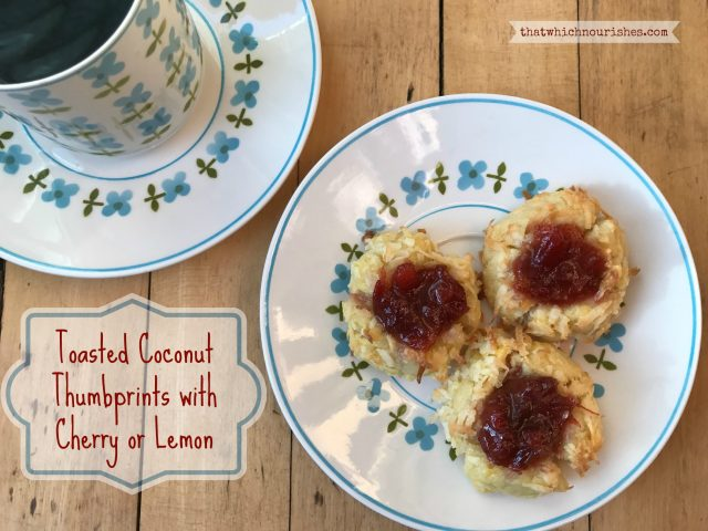 Coconut Thumbprints with Cherry or Lemon -- Buttery shortbread cookies are covered in coconut and filled with tart jam or homemade lemon curd for a rich cookie in a beautiful little bundle of yum. | thatwhichnourishes.com