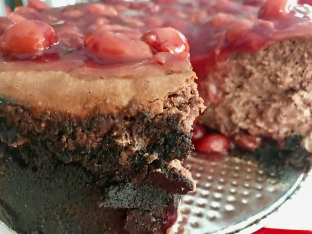 Steel Magnolias Chocolate Cherry Cheesecake -- A decadent and creamy chocolate cheesecake is encrusted with two kinds of buttery, chocolate crumbs and layered with cherries to make a delightful dessert for any special occasion. | thatwhichnourishes.com