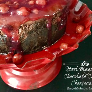 Steel Magnolia Chocolate Cherry Cheesecake -- A decadent and creamy chocolate cheesecake is encrusted with two kinds of buttery, chocolate crumbs and layered with cherries to make a delightful dessert for any special occasion. | thatwhichnourishes.com