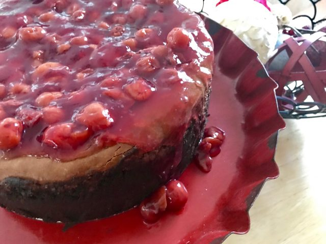 Steel Magnolias Chocolate Cherry Cheesecake -- A decadent and creamy chocolate cheesecake is encrusted with two kinds of buttery, chocolate crumbs and layered with cherries to make a delightful dessert for any special occasion.   thatwhichnourishes.com