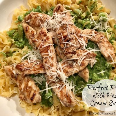 Perfect Pasta with Pesto Cream Sauce -- Grilled chicken, and freshly made pesto are tossed into pasta with a bit of butter and cream to make a fast and easy nourishing meal. | thatwhichnourishes.com