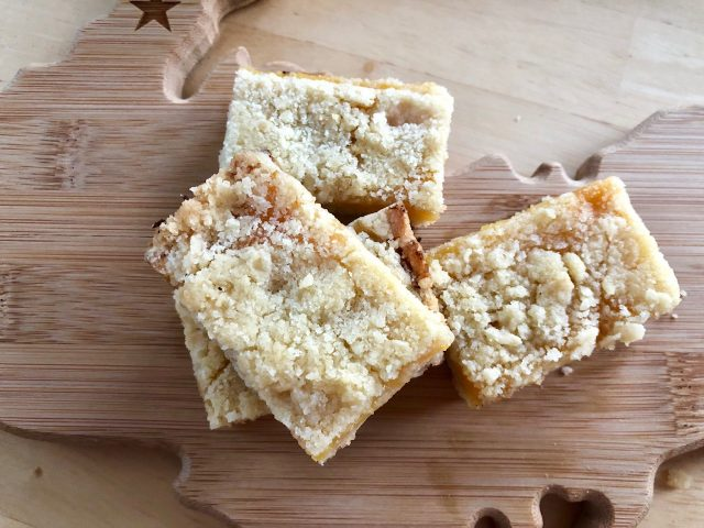 Lemon Crumb Bars -- Tart, bright and as lemony-delicious as a dessert can get, these Lemon Crumb Bars with their soft, buttery crumbs and lemon curd filling are quick to make and quicker to disappear! | thatwhichnourishes.com