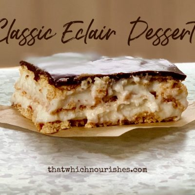 Classic Eclair Dessert -- Layers of vanilla pudding folded into homemade, sweetened whipped cream, and graham crackers topped with blanket of homemade, silky-rich, chocolate ganache.  This is dessert heaven! | thatwhichnourishes.com