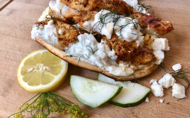Easy Chicken Gyros and Tzatziki Sauce -- Marinated chicken piled on naan bread and blanketed with homemade tzatziki sauce loaded with garlic, dill, and cucumbers and then covered in rich feta. | thatwhichnourishes.com