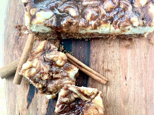 Cinnamon Roll Cheesecake Squares --Goozy cinnamon roll filling draped and dripping from atop perfectly creamy little squares of cheesecake. These are all of the cinnamon-roll-love without the work! | thatwhichnourishes.com
