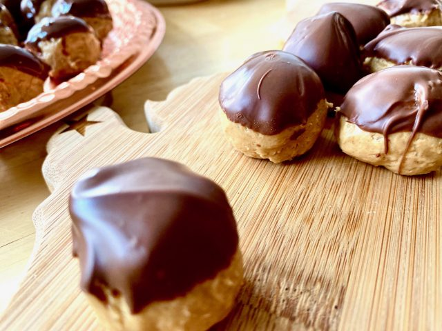 Chocolate Peanut Butter Balls -- Sweetened peanut butter with the crunch of crispy rice cereal dipped quickly into melted chocolate makes a whole bunch of happy Christmas-treat-eaters with very little fuss for you -- an easy, no-bake, last-minute dessert! | thatwhichnourishes.com