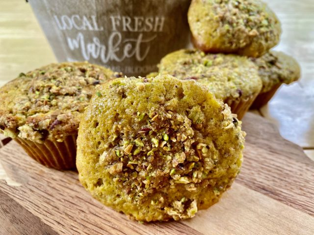 Pistachio Crunch Muffins -- Sweetened with maple syrup, these pleasantly pistachioed, soft muffins made from scratch are crowned with a buttery, streusel topping. | thatwhichnourishes.com