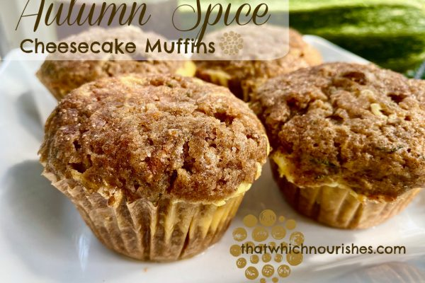 Autumn Spiced Cheesecake Muffins -- Soft, moist muffins spiced with all the warm, Autumn spices and layered with stripe of cheesecake-goodness. Filled with zucchini, carrots, coconut oil, and maple syrup, these beauties are as nourishing as they are delicious! | thatwhichnourishes.com