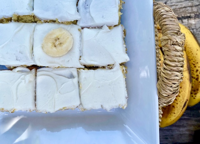 Tami's Frosted Banana Bars -- Soft and moist banana cake frosted with a simple yet decadent vanilla frosting. I dare you to try and eat just one! | thatwhichnourishes.com